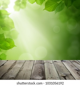 Green Leaves, Bokeh Light and Empty Wooden Table on Spring Health Background