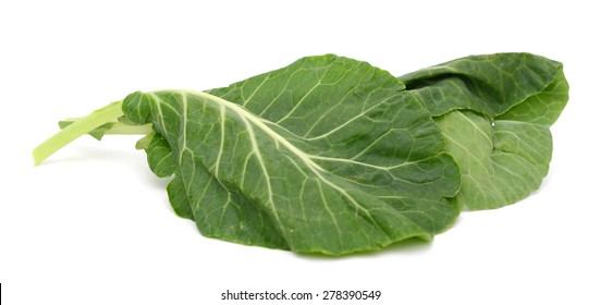 green leaves of collards isolated on white