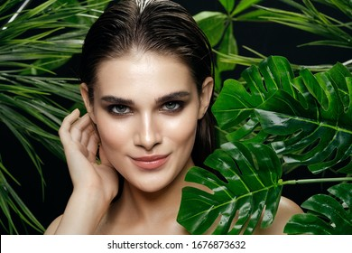 Green leaves of a palm tree for a woman on the nature of the model