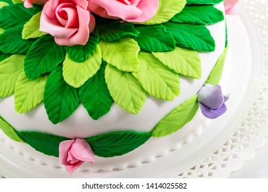 Green leaves and pink rose marzipan cake decoration idea