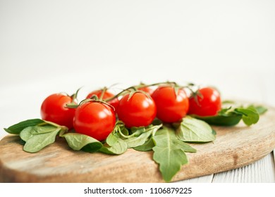 green leaves and red tomatoes on the blackboard