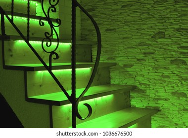 Green LED lighting wooden stairs with antique railing