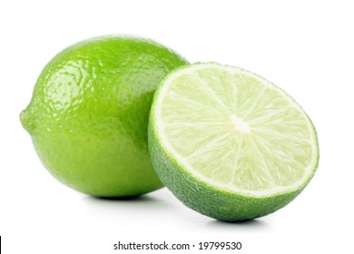 green lemon and slice isolated on white