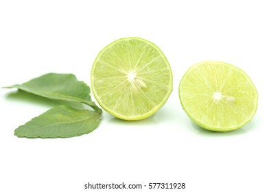 green lemon slice isolated on white background