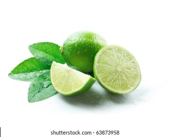 Green lemons on white background