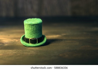 Green Leprechaun hat on wood table. Saint Patrick's Day concept