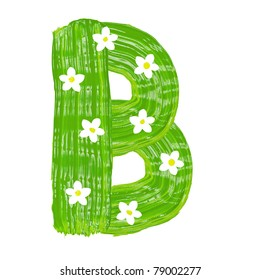 The green letters B drawn by paints with white blossom