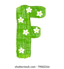 The green letters F drawn by paints with white blossom