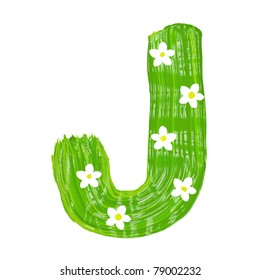The green letters J drawn by paints with white blossom