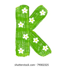 The green letters K drawn by paints with white blossom