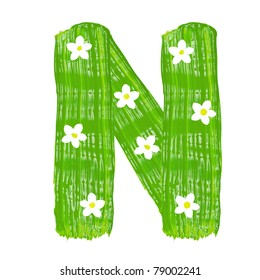 The green letters N drawn by paints with white blossom