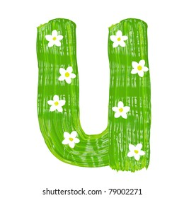 The green letters U drawn by paints with white blossom