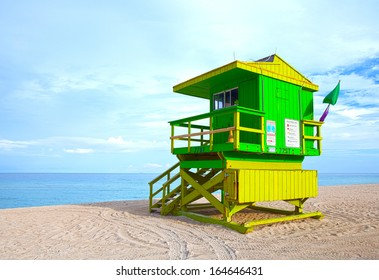 Green lifeguard house in South Beach, Miami Beach Florida on late summer afternoon with ocean in the background