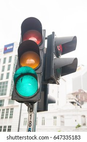 green light on traffic light at intersection , road