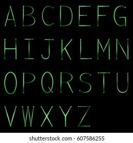 green light painting alphabet on black background