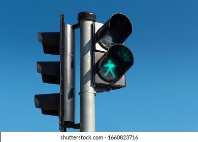 Green light for pedestrians on the blue background.