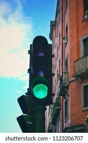 Green light of traffic light on the street