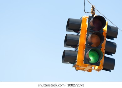 A Green light traffic signal with blue sky copy space