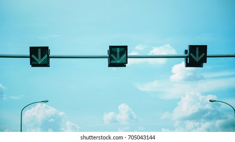 The green light traffic signal with cloudy blue sky