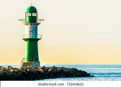 green lighthouse of Warnemuende on the Baltic Sea at the harbor , Germany Rostock