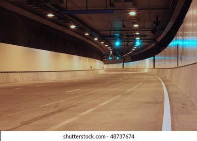 Green Lights Ahead inside an empty urban tunnel.