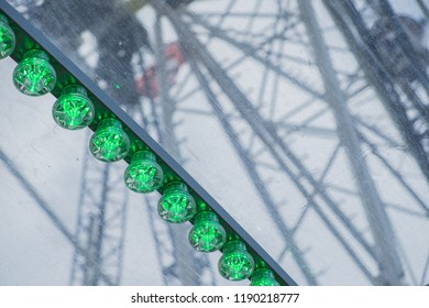 Green lights of a big wheel on a fair in Thun in Swiss