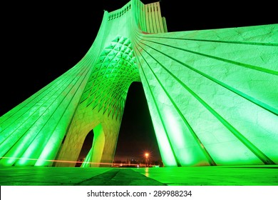 Green lights of popular Azadi (Liberty) Tower at night in Tehran. One of the symbols of Tehran city, the capital of Iran, and marks the west entrance to the city.