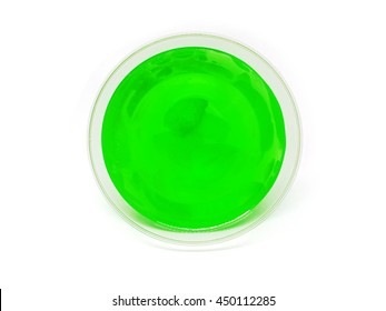 Green lime jelly with fruit piece in a plastic cup placed on its side with clipping path.