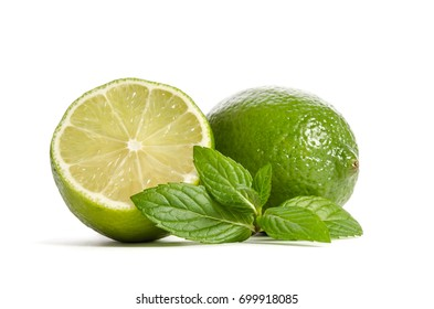 green lime and mint  with slice of  juicy lime isolated on white background