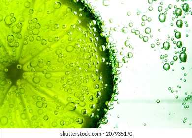Green lime with water splash isolated on white background