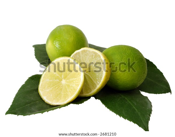 Green limes on leaves over white background