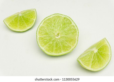 Green Limes on a white Bacvkground