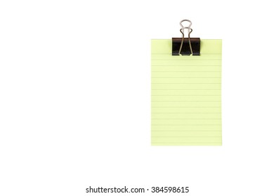 Green lined note paper with color pencils on white for background