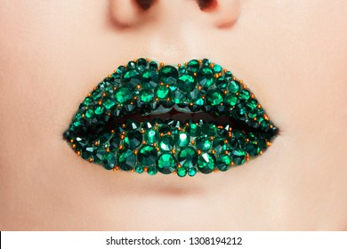 Green lips covered with rhinestones. Beautiful woman with Green lipstick on her lips, concept cosmetics