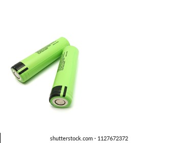 Green lithium-ion battery size 18650 isolated on white background