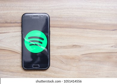 The green logo of the Spotify application on the screen of a Samsung phone. March 2018 in Rzeszow, Poland