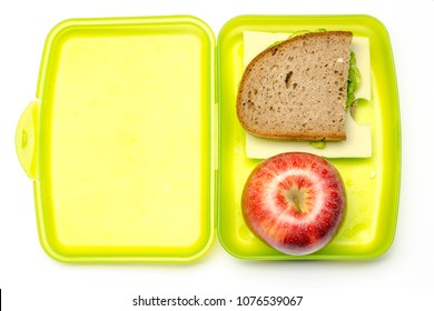 green lunchbox with bread and apple, white background, isolated