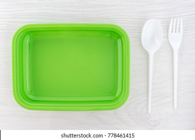Green lunchbox, fork and spoon