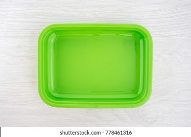 Green lunchbox on white background top view