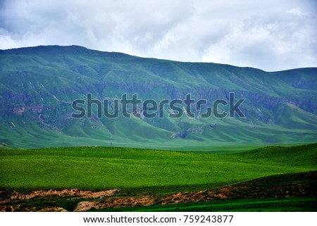 green lush mountain along the way to Dushanbe, fresh roadside view of countryside on spring time, Tajikistan,central asia.