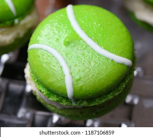 Green macarons hor' d'oeuvres filled with vanilla ice cream on crystal  glass dish
