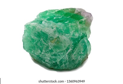 Green magenta and translucent fluorite mineral stone crystal isolated on white limbo background