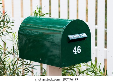 Green mail box with the number 42 on it.