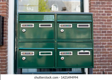 Green mailboxes with Ja/Nee Yes/No sticker to prevent unwanted post such as advertising