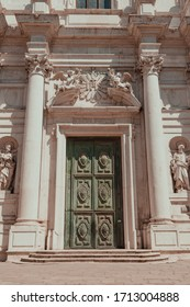 Green majestic door with white collumns