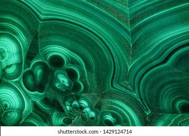 The green malachite. An ornamental stone. Photo texture. Macro.