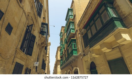 Green Maltese Windows and Balcony, low angle horizontal photography summer 2018