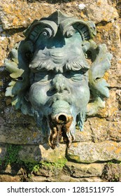 Green man water spout made of bronze. A pagan green man water spout made of bronze from an English stately home.