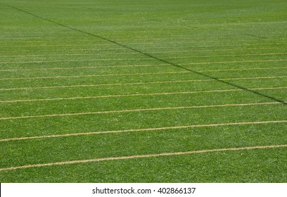 Green manicured sports field background with a parallel lines pattern/Pitch Pattern/Sports and Recreation