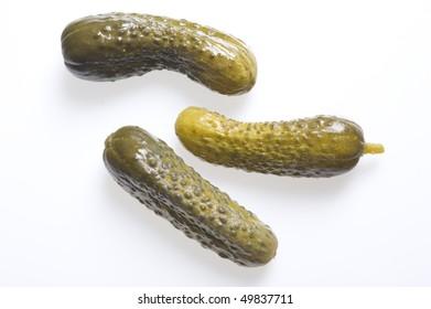 Green marinated cucumber  isolated on white background